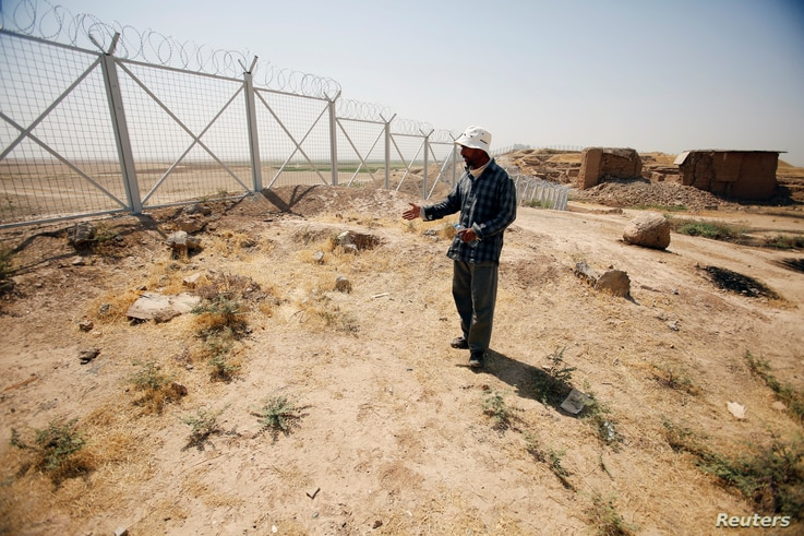 One of the citizens of the Nimrud city refers to the place of Agatha's Christie former residence in the Nimrud Archaeological city in south of Mosul, Iraq, Aug. 1, 2017.