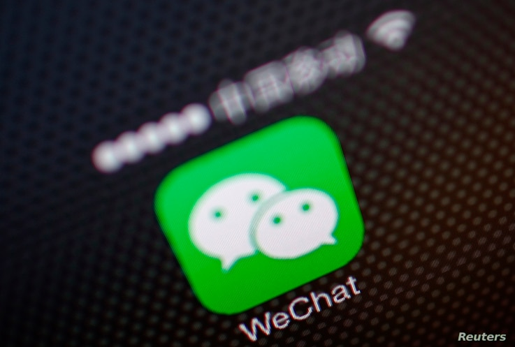 FILE - A picture illustration shows a WeChat app icon in Beijing, Dec. 5, 2013.