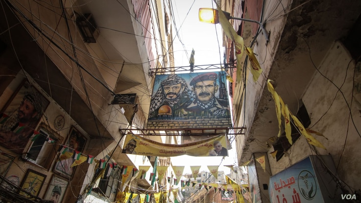 Flags and banners bearing the Palestinian insignia and political figures line Bourj el Barajneh, one of 12 Palestinian camps in Lebanon. (J. Owens/VOA)
