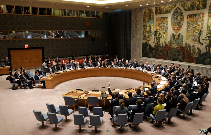 The United Nations Security Council votes on a resolution during a meeting at U.N. headquarters, March 2, 2016.