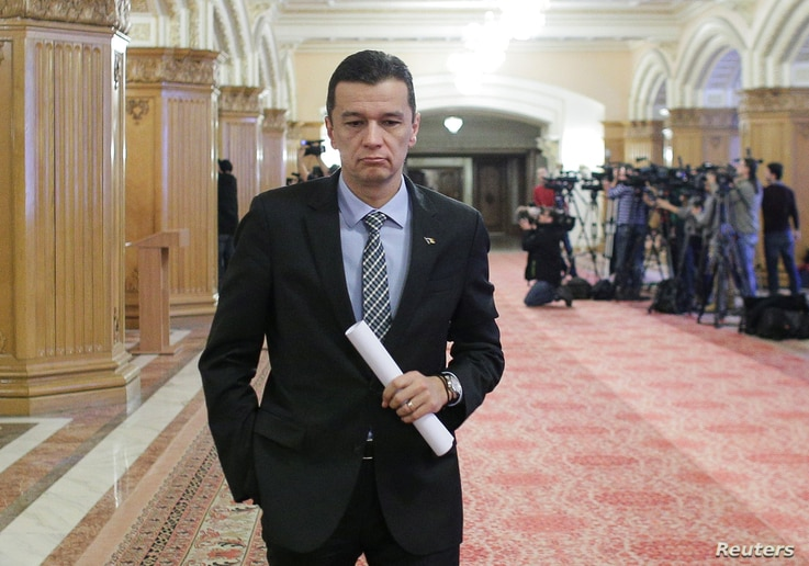Romania's Prime Minister Sorin Grindeanu leaves a meeting at the parliament in Bucharest, Feb. 6, 2017.