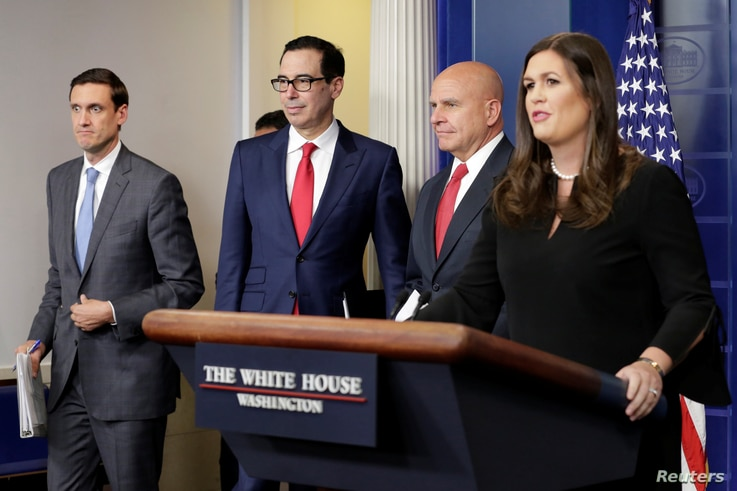 Homeland security adviser Tom Bossert, U.S. Treasury Secretary Steve Mnuchin, national security adviser H.R. McMaster and White House press secretary Sarah Huckabee Sanders arrive at a news briefing at the White House in Washington to announce sancti