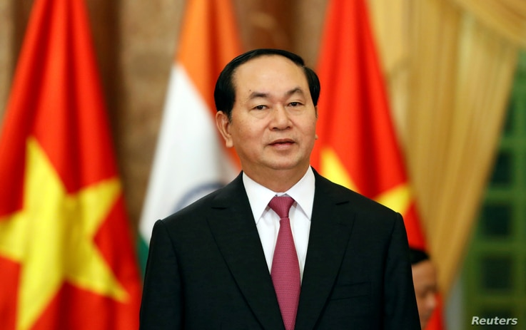 Vietnam's President Tran Dai Quang waits for the arrival of India's Prime Minister Narendra Modi