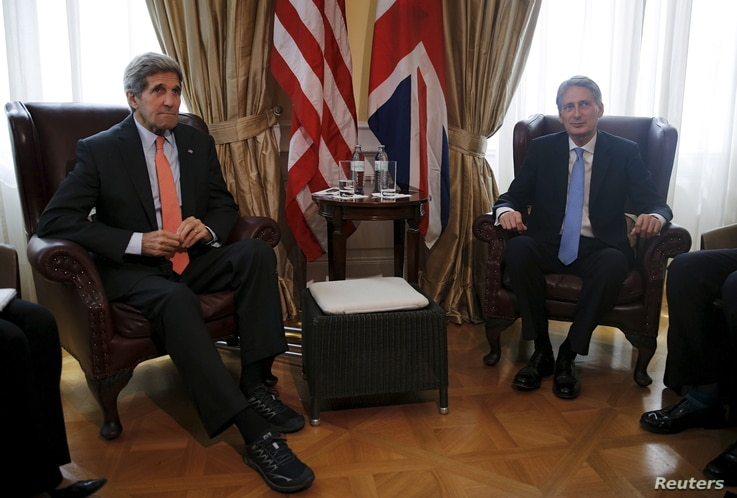 U.S. Secretary of State John Kerry (L) meets with British Foreign Secretary Philip Hammond at a hotel where the Iran nuclear talks meetings are being held in Vienna, Austria, July 2, 2015.