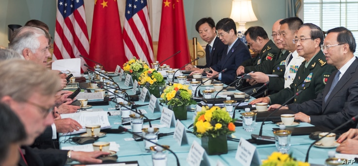 US Secretary of State Rex Tillerson(center left), and US Secretary of Defense Jim Mattis(obscured), hosts Chinese State Councilor Yang Jiechi, and Chief of the People's Liberation Army Joint Staff Department General Fang Fenghui, right, as the two co...