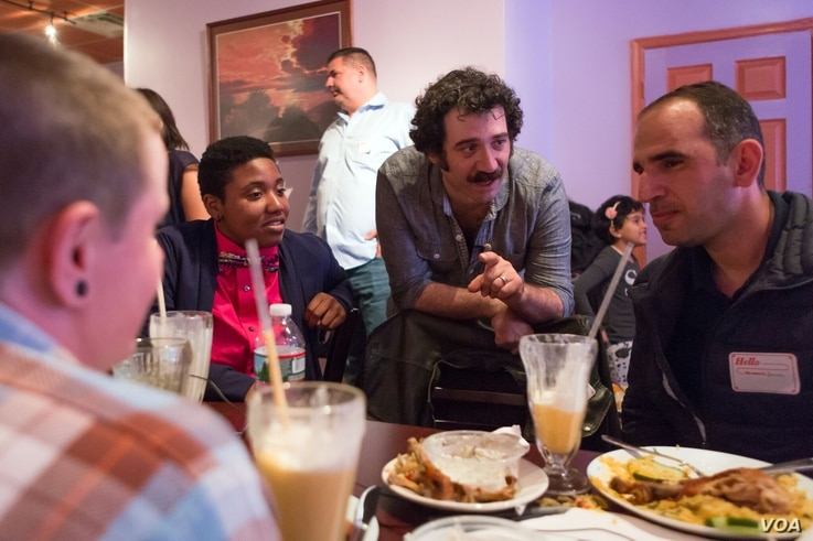 Michael Rakowitz (center, with mustache), brought together American veterans of Iraqi conflicts with Philadelphia-area Iraqi refugees for a group dinner in May 2017.