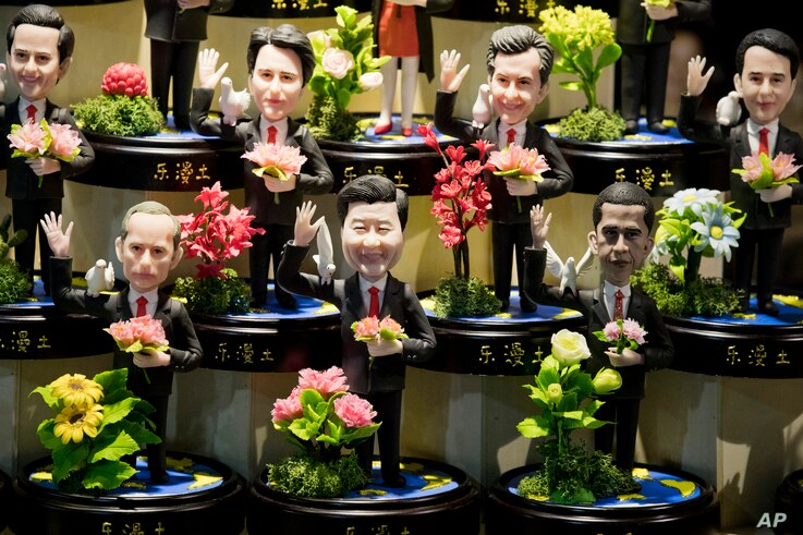 Clay figures, showing U.S. President Barack Obama, Chinese President Xi Jinping and Russian President Vladimir Putin amongst other state leaders expected to attend the G20 summit are displayed at a shop in Hangzhou in eastern China's Zhejiang provin...