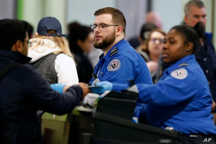 Transportation Security Administration officers work at a checkpoint at Logan International Airport in Boston, Jan. 5, 2019.