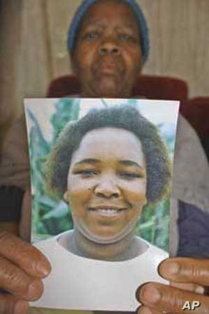 Masentle Mohajane holds a picture of her daughter, Johanna, who died, she says, after state medical staff failed to give ARVs to the HIV infected woman
