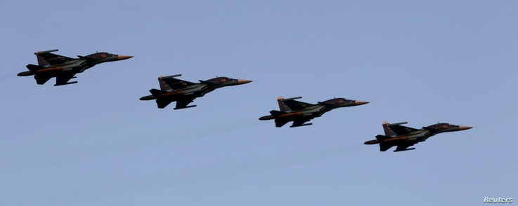 FILE - Russian Air Force Su-34 fighter-bombers take part in a military parade during celebrations marking Independence Day in Minsk.