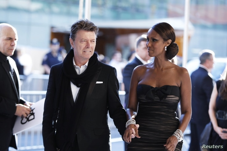 Singer David Bowie arrives with his wife Iman to attend the CFDA fashion awards in New York, June 7, 2010.