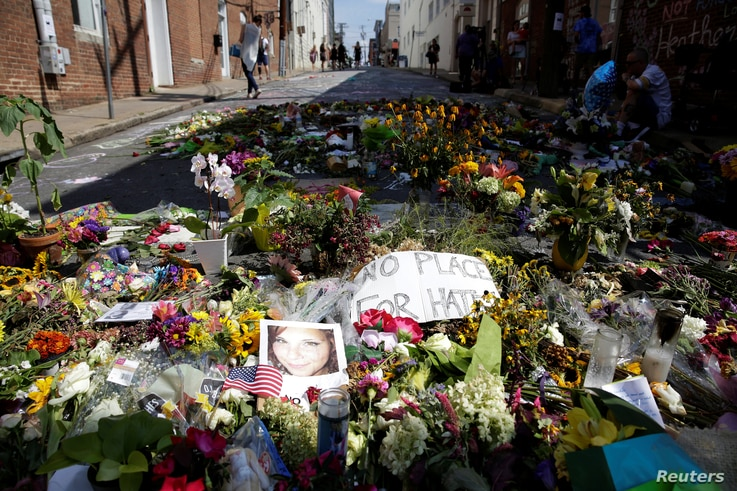 Flowers are pictured on the street where Heather Heyer was killed when a suspected white nationalist crashed his car into anti-racist demonstrators in Charlottesville, Virginia, U.S., Aug. 16, 2017.