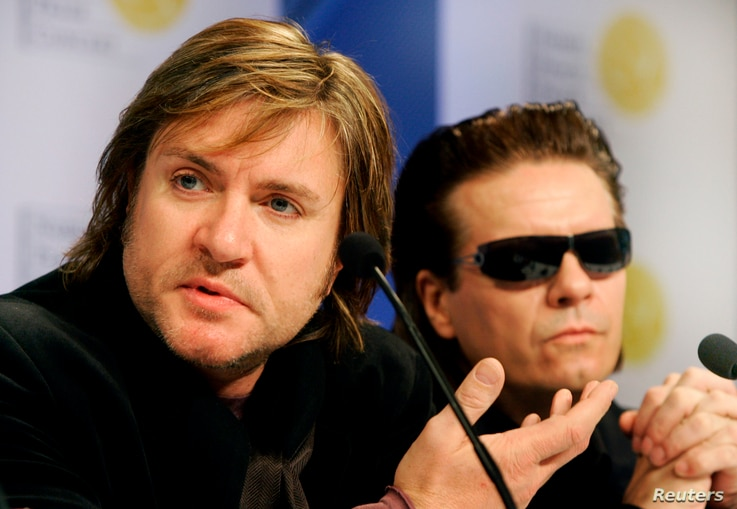 FILE - British band Duran Duran's Simon Le Bon (L) and Andy Taylor attend a news conference.