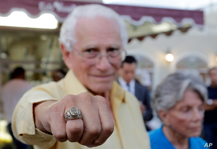 Cuban-American and veteran of Bay of Pigs Armando Gutierrez, proudly shows his Brigade ring, Jan. 12, 2017, in the Little Havana area in Miami.