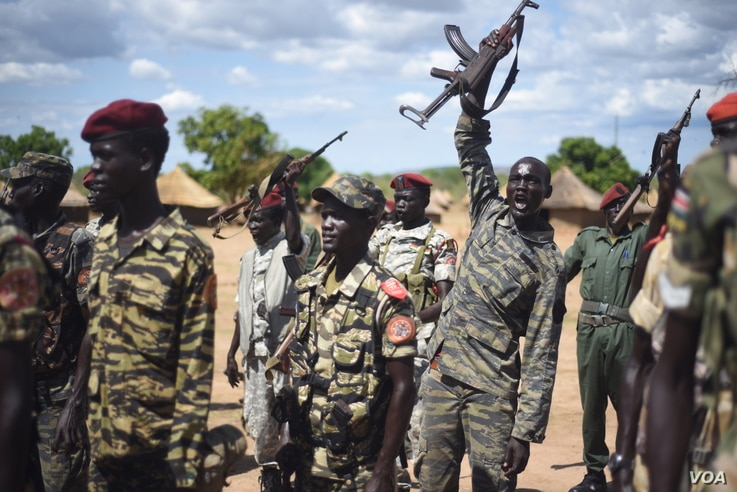 A South Sudanese government soldier raises his gun and chants at Jebel Makor, 45 minutes outside South Sudan's capital Juba, April 14, 2016. The soldiers were brought here as part of a process to reduce the number of troops in the city before the arr...