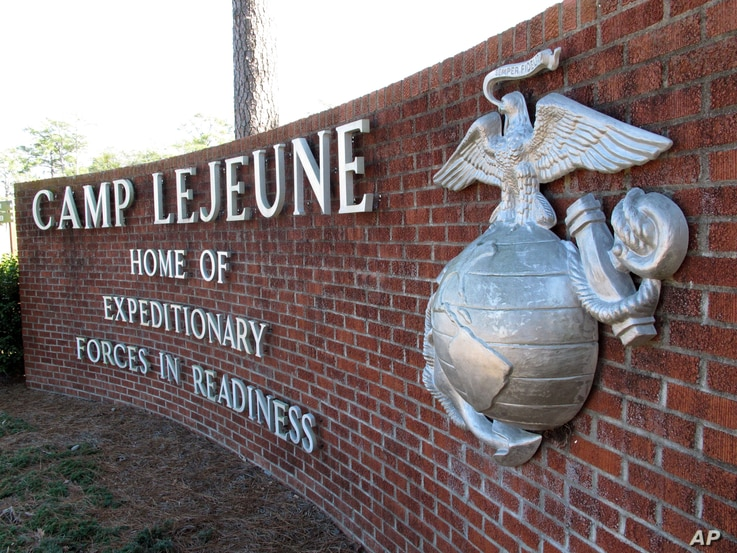 FILE - This photo, taken March 19, 2013, shows the globe and anchor sign at the entrance to Camp Lejeune, North Carolina.