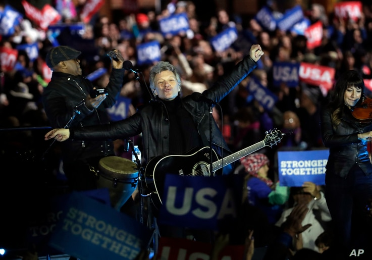Jon Bon Jovi acknowledges applause after performing during a Hillary Clinton campaign event at Independence Mall in Philadelphia, Nov. 7, 2016.