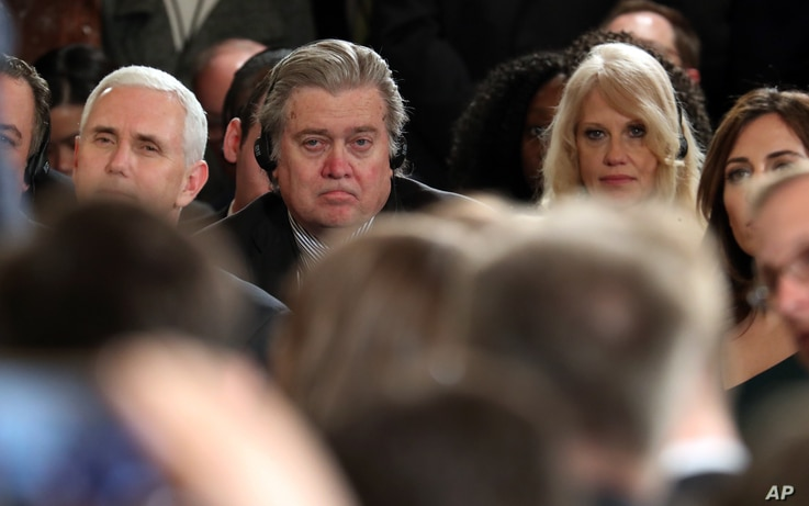 From left, Vice President Mike Pence, chief White House strategist Steve Bannon and presidential counselor Kellyanne Conway sit together in the audience during a joint news conference held by President Donald Trump and German Chancellor Angela Merkel...