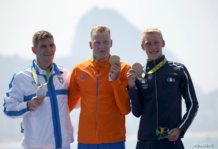 Gold medalist Ferry Weertman (NED) of the Netherlands, silver medalist Spiros Gianniotis (GRE) of Greece (L) and bronze medalist Marc-Antoine Olivier (FRA) of France (R) pose with their medals for Men's 10km Marathon Swimming, Rio de Janeiro, Aug. 16...