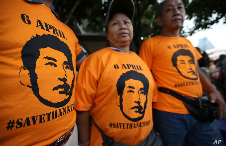 Supporters wear T-shirts with the image of Thailand's Future Forward Party leader Thanathorn Juangroongruangkit before his arrival at a police station Bangkok, Thailand, April 6, 2019.
