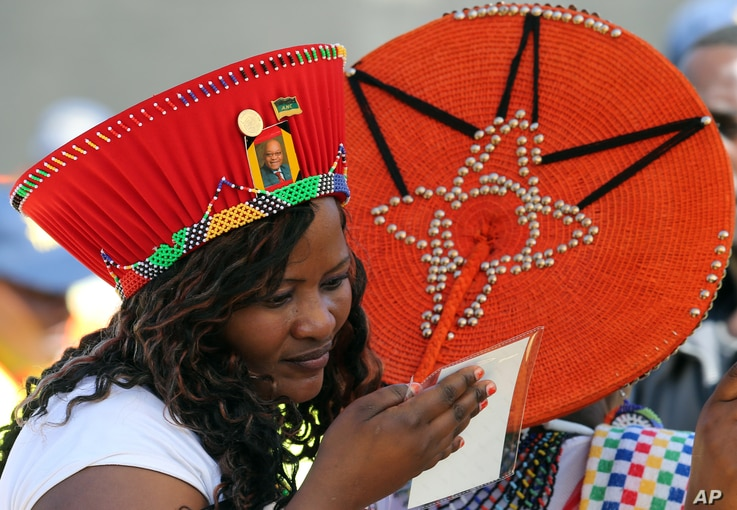 A supporter of the ruling African National Congress party checks her accreditation for the inauguration in Pretoria, South Africa, May 24, 2014.