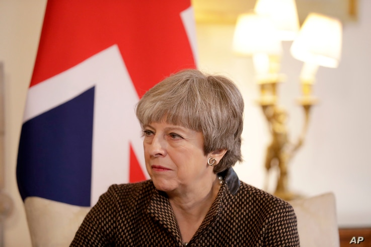 "FILE - British Prime Minister Theresa May is seen during a meeting at 10 Downing Street in London, Britain, Nov. 27, 2017. In a rare rebuke, May has called President Donald Trump's retweeting of anti-Muslim videos ""wrong."""