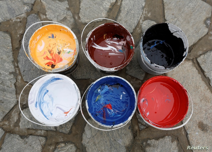 Containers of colors, prepared by Artlords which are used to paint graffiti on the concrete blast walls, are seen in Kabul, Afghanistan, Feb. 14, 2018.