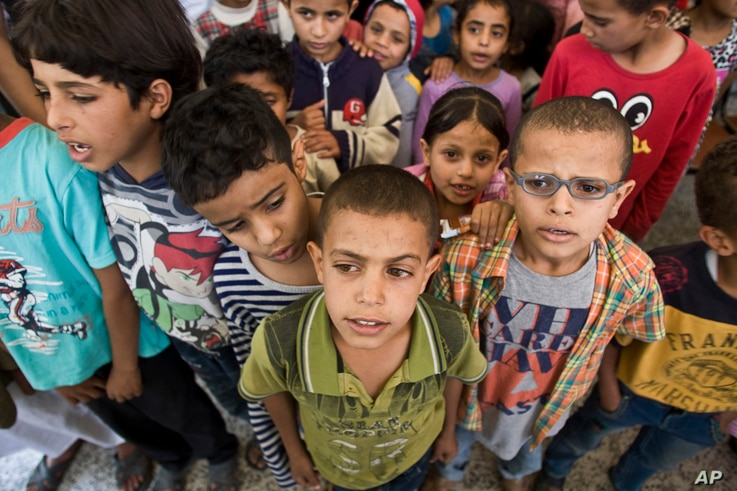 Displaced boys who fled their home after a Saudi-led airstrike destroyed their houses, live in a school in Sanaa, Yemen, Thursday, May 14, 2015.