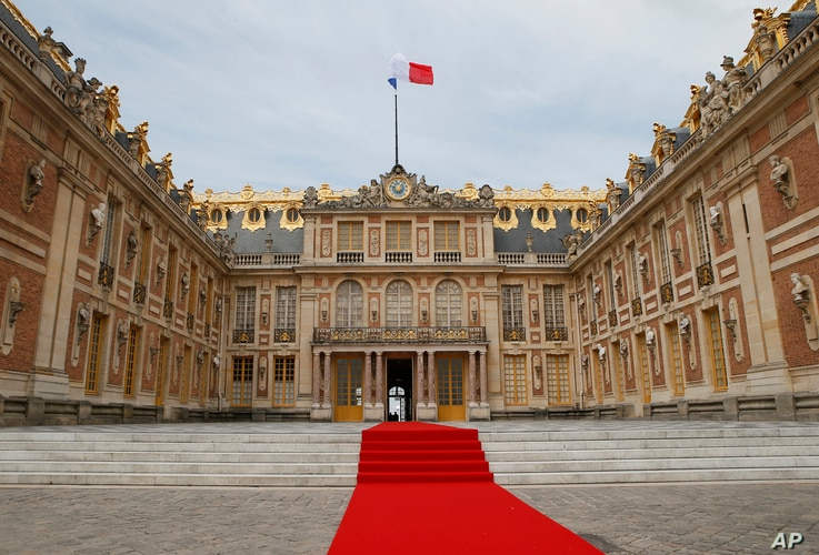 FILE - The red carpet is set up prior to a ceremony at the Palace of Versailles, near Paris, France, May 29, 2017.