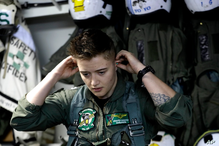 Lt. Jennifer Sandifer, a fighter pilot from Texas, prepares to launch from the U.S.S. Dwight D. Eisenhower aircraft carrier towards targets in Iraq and Syria, Nov. 22, 2016.