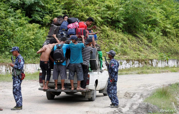 Ethnic Rakhine people who fled from Maungdaw after Arakan Rohingya Salvation Army (ARSA) had attacked, arrive in Buthidaung, Myanmar, Aug. 28, 2017.
