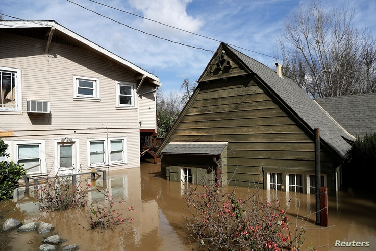 Homes are submerged after Coyote Creek flooded nearby neighborhoods and prompted an evacuation in San Jose, California, Feb. 22, 2017.