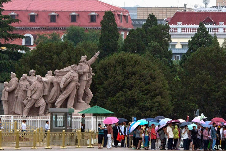 Visitors line up on Tiananmen Square on a rainy day in Beijing, June 4, 2015. In what's become an annual ritual, Chinese police were stepping up their vigilance in the capital Thursday to prevent any remembrance of the event.