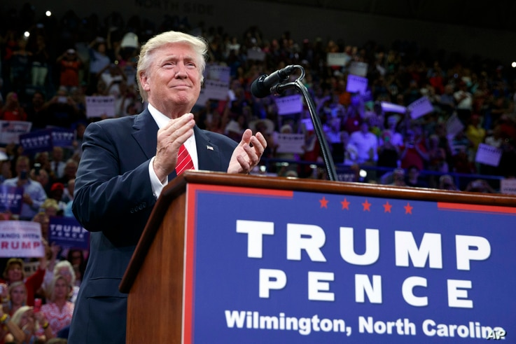 Republican presidential candidate Donald Trump applauds during a campaign rally at the University of North Carolina Wilmington, Tuesday, Aug. 9, 2016.
