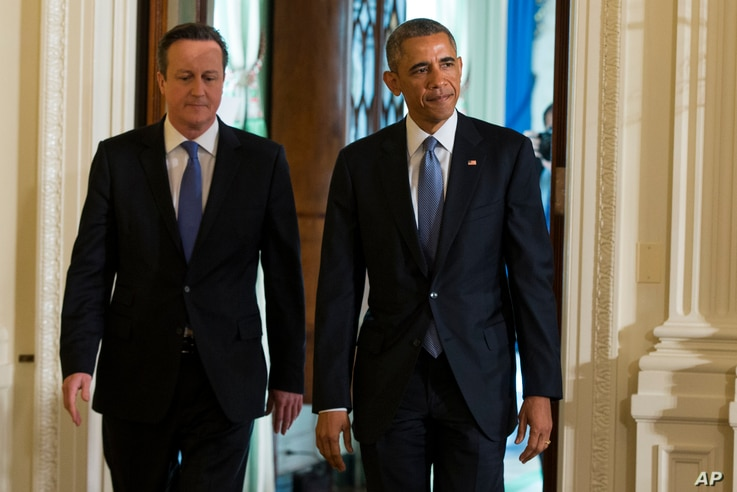 President Barack Obama and British Prime Minister David Cameron arrive for a joint news conference in the East Room of the White House in Washington, Friday, Jan. 16, 2015.