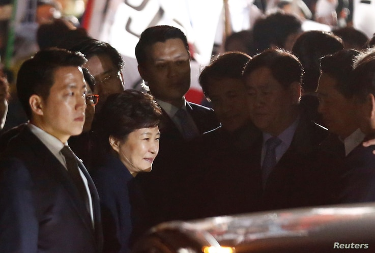 South Korea's ousted leader Park Geun-hye greets her supporters as she arrives at her private home in Seoul, South Korea, March 12, 2017.