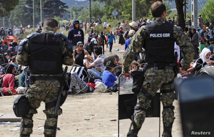 Macedonian special policemen guard the border as more than a thousand immigrants wait at the border line of Macedonia and Greece to enter Macedonia near the Gevgelija railway station August 21, 2015. Macedonian police drove back crowds of migrants an...