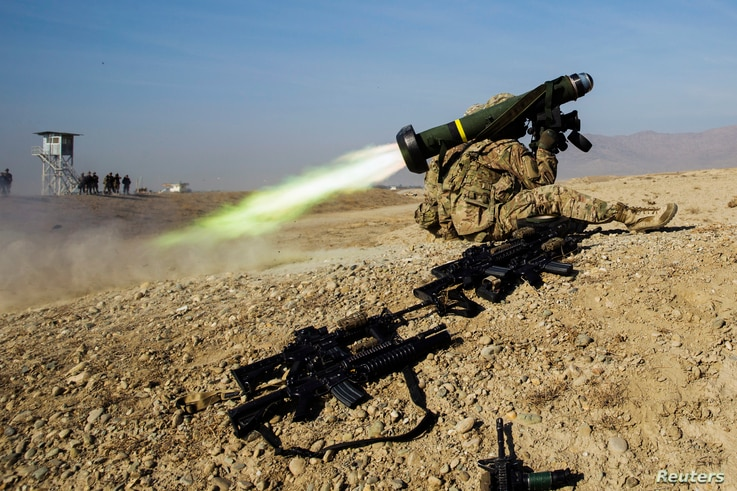 FILE - A U.S. soldier from Dragon Troop of the 3rd Cavalry Regiment fires a Javelin missile system during training in Laghman province, Afghanistan, Jan. 1, 2015.