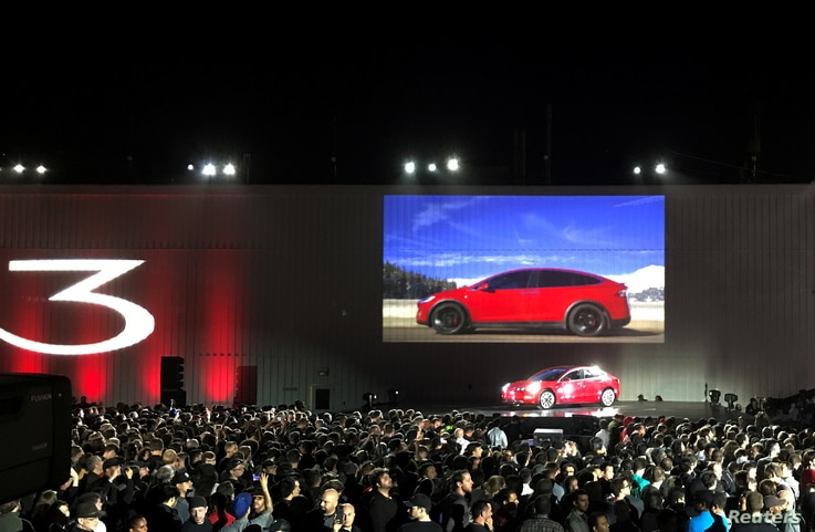 Tesla introduces one of the first Model 3 cars off the factory's production line during an event at the company's facilities in Fremont, California, July 28, 2017.