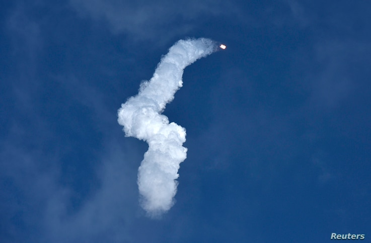 A SpaceX Falcon Heavy rocket leaves a smoke trail behind after lifting off from historic launch pad 39-A at the Kennedy Space Center in Cape Canaveral, Florida, Feb. 6, 2018.