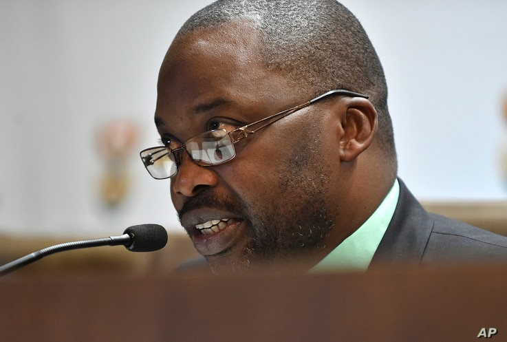 South Africa's minister of justice and correctional services, Michael Masutha, speaks to the press in Pretoria, South Africa, Oct. 21, 2016. Masutha said South Africa will soon seek to withdraw from the International Criminal Court.