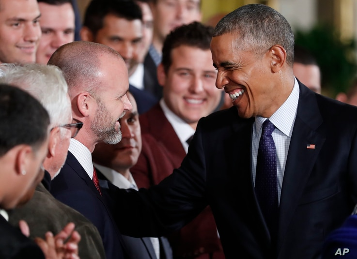 President Barack Obama talks with catcher David Ross, who retired after the World Series, during a ceremony in the East Room of the White House, Jan. 16, 2017. The Cubs have named Ross a special assistant.