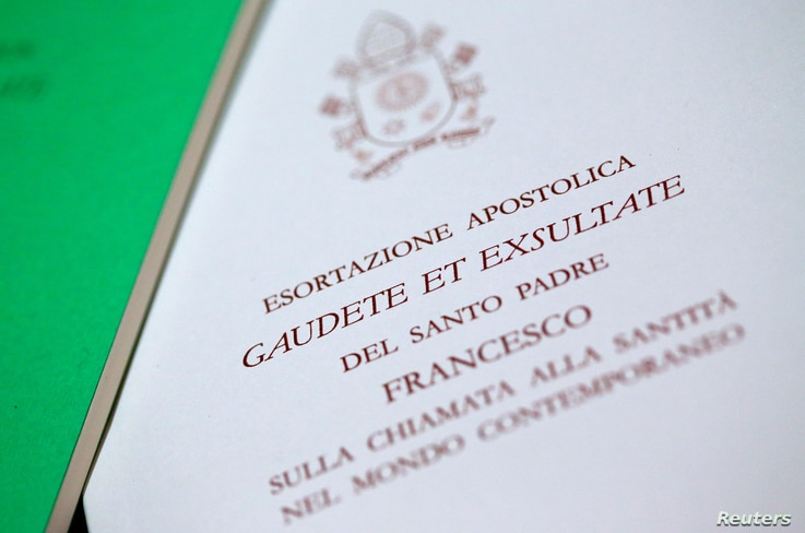 A Pope Francis document, known as an apostolic exhortation, entitled Gaudete et exsultate (Rejoice and be glad), is seen in this picture illustration taken at the Vatican, April 9, 2018.