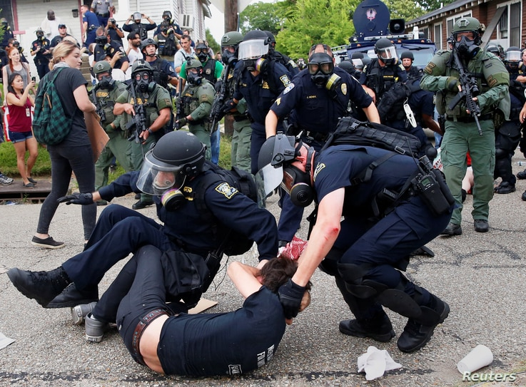 A demonstrator is detained by police during protests in Baton Rouge, Louisiana, U.S., July 10, 2016.
