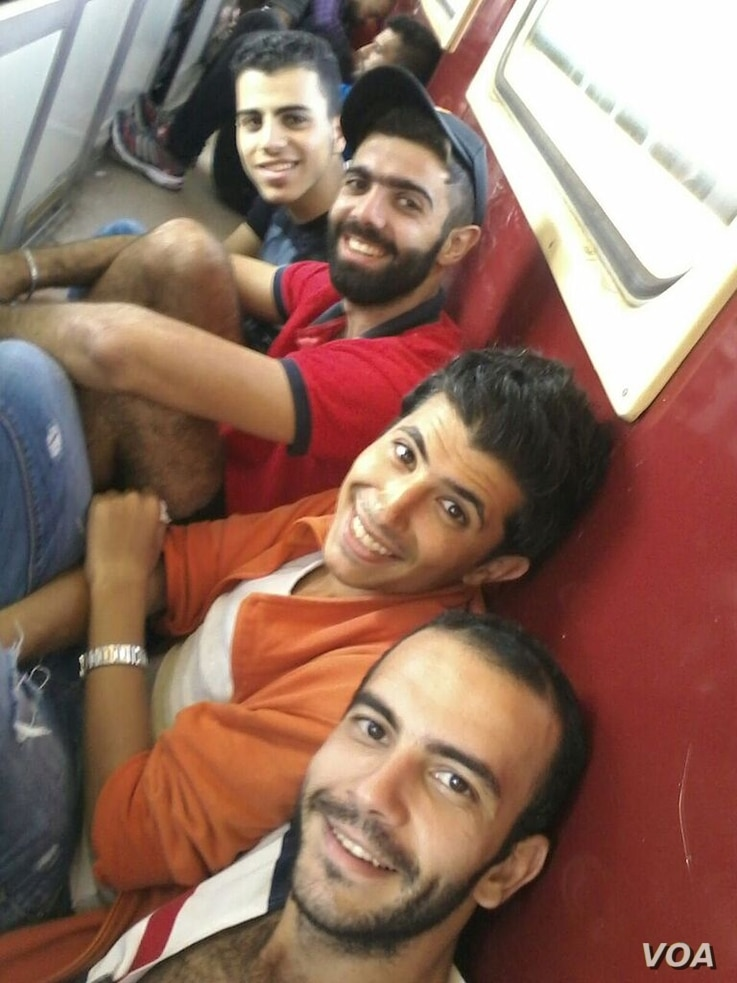 The guys on the train across Macedonia as governments rush to get refugees in and out, afraid their neighbors will close their borders.  Sept. 2015. (VOA/Courtesy)