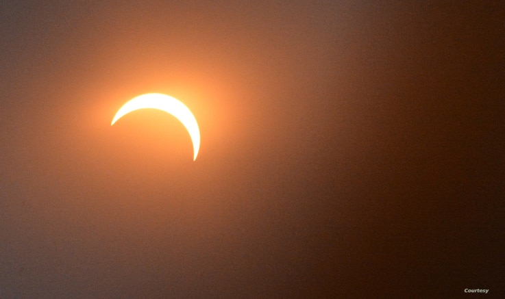 The moon is seen blotting out 81 percent of the sun during a solar eclipse in Washington, D.C., Monday, Aug. 21, 2017. (Photo by Diaa Bekheet)