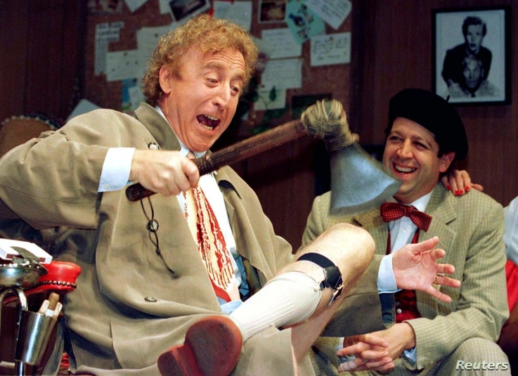 FILE - American actor Gene Wilder (L) performs alongside compatriot Rolf Saxon, during the rehearsal of a scene from Neil Simon's 'Laughter on the 23rd Floor', in New York, Oct. 2, 1996.