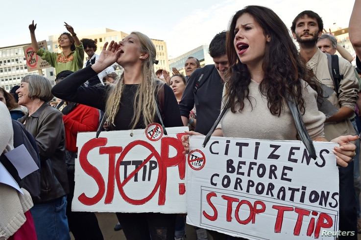 Thousands of people demonstrate against the Transatlantic Trade and Investment Partnership (TTIP) and the EU-Canada Comprehensive Economic and Trade Agreement (CETA) in the center of Brussels, Belgium, Sept. 20, 2016.