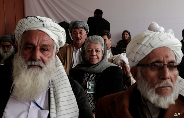 Afghan delegates listen to a speech from their committee chairman on the second day of the Loya Jirga, Kabul, Nov. 22, 2013.