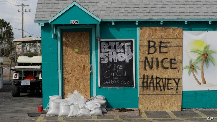 "A sign reading ""Be Nice Harvey"" was left behind on a boarded up business, Aug. 24, 2017, in Port Aransas, Texas."